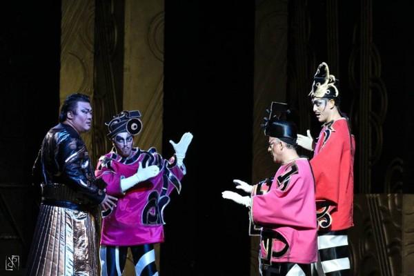 Turandot. Park (Calaf) and the Three Masks  Ping Pang Pong. photo Luca Ramacciotti